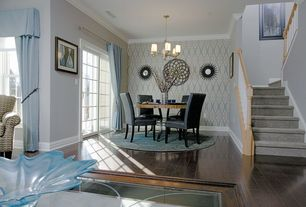 Traditional Dining Room with Chandelier, Hardwood floors, Crown molding, interior wallpaper, Standard height, French doors
