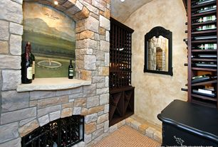 Mediterranean Wine Cellar with Wine storage, Standard height, Built-in bookshelf, interior wallpaper, stone fireplace
