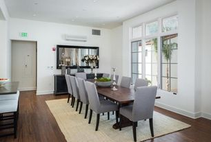 Contemporary Dining Room with can lights, Hardwood floors, picture window, Standard height, Casement