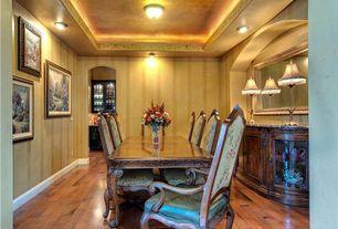 Country Dining Room with Hardwood floors, interior wallpaper, flush light