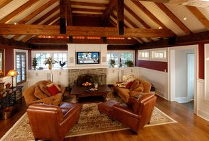 Country Living Room with Exposed beam, Wainscotting, flush light, Fireplace, double-hung window, Hardwood floors, Casement