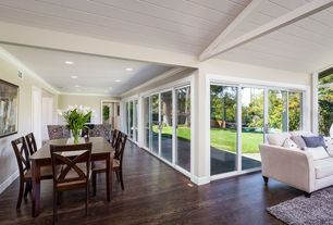 Contemporary Dining Room with Crown molding, Hardwood floors