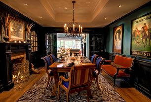Eclectic Dining Room with Standard height, Wainscotting, Crown molding, brick fireplace, Glass panel door, Fireplace
