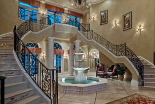 Traditional Entryway with Columns, Couristan Everest Isfahan/Crimson Area Rug, Chandelier, sandstone floors, High ceiling