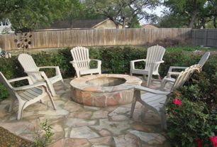 Traditional Patio with exterior stone floors, Fire pit, Fence