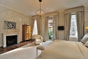 Traditional Master Bedroom with Crown molding, Arteriors Home End Table, Sunpan Modern Fitch Armchair, Balcony, Chandelier