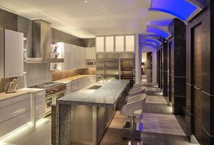 Contemporary Kitchen with Built In Refrigerator, Standard height, Glass Tile, built-in microwave, U-shaped, Wall sconce