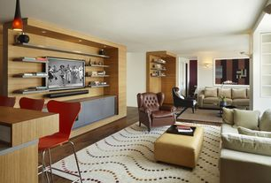 Contemporary Living Room with Hardwood floors, flat door, Built-in bookshelf, Pendant light, Wall sconce, Standard height