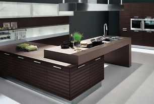 Modern Kitchen with Stellar stainless steel utensil rack, double wall oven, stone tile floors, electric cooktop, U-shaped