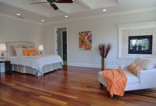 Contemporary Master Bedroom with Ceiling fan, Standard height, can lights, Laminate floors, Fireplace, insert fireplace
