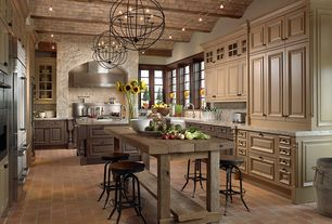 Country Kitchen with Paint, can lights, Restoration hardware - salvaged wood kitchen table, Flush, terracotta tile floors