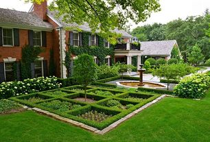 Traditional Landscape/Yard with Fountain, Washington Hawthorn, Pathway, English box hedge, Raised beds