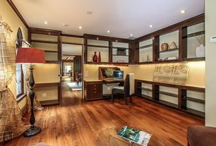 Contemporary Home Office with Crown molding, Hardwood floors, Arched window, Built-in bookshelf