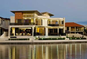Contemporary Exterior of Home with Waterfront, Poured concrete