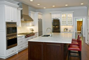 Traditional Kitchen with Wolfe gas cooktop, Wolf - double wall oven, U-shaped, Stainless undermount 2-basin sink, Flush