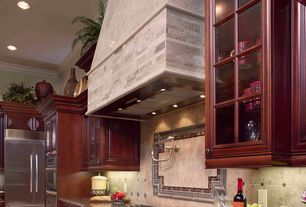 Traditional Kitchen with Simple granite counters, full backsplash, Stone Tile, can lights, Glass panel, Wall Hood, L-shaped