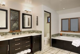 Contemporary Master Bathroom with European Cabinets, Corian counters, Casement, partial backsplash, can lights, Flush