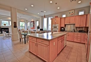 Contemporary Kitchen with Soapstone counters, Pendant light, L-shaped, Breakfast bar, Stainless Steel, Inset cabinets