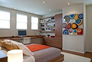 Modern Guest Bedroom with Built-in bookshelf, Onime wooden bed, Hardwood floors, Serge leather chair