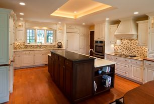 Traditional Kitchen with Ceramic Tile, Breakfast nook, Kitchen island, Undermount sink, Simple granite counters, Raised panel