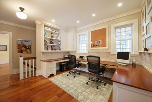 Traditional Home Office with Built-in bookshelf, Hardwood floors, flush light, double-hung window, Crown molding, can lights