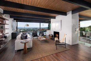 Contemporary Living Room with Hardwood floors, Built-in bookshelf, Exposed beam