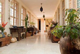 Eclectic Hallway with travertine tile floors