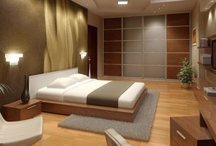 Contemporary Master Bedroom with Wall sconce, flat door, Laminate floors, Built-in bookshelf, Standard height, flush light