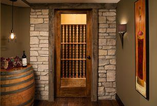 Mediterranean Wine Cellar with French doors, Built-in bookshelf, Pendant light, Wall sconce, Hardwood floors