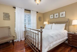 Traditional Guest Bedroom with The American Iron Bed Company Dorset Bed, Hardwood floors, flush light