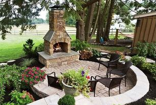 Rustic Patio with Raised beds, outdoor pizza oven, exterior stone floors, Fence, Threshold Metal Mesh Dining Chair