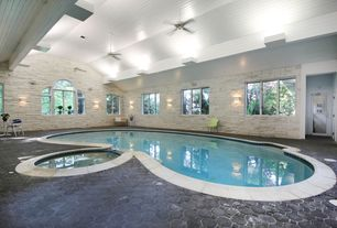 Contemporary Swimming Pool with exterior stone floors, Pool with hot tub, Stone wall facade, Arched window, Indoor pool