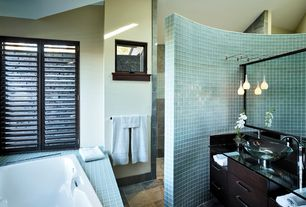 Modern Master Bathroom with stone tile floors, Wall Tiles, Pendant light, Bathtub, linen and towel storage cabinet, Flush
