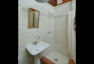 Mediterranean 3/4 Bathroom with terracotta tile floors, Pedestal sink, Pendant light, Daltile blavet blanc tumbled limestone
