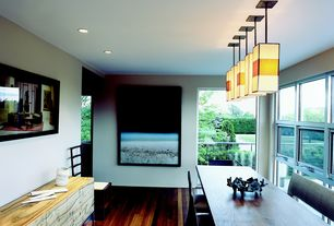 Contemporary Dining Room with flush light, Hardwood floors, can lights, picture window, Casement, Balcony, Standard height
