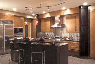 Modern Kitchen with Kitchen island, Soapstone counters, Stainless Steel, Wall Hood, full backsplash, gas range, L-shaped