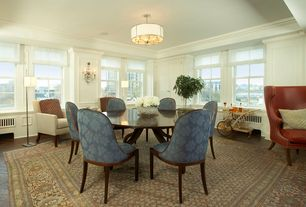 Traditional Dining Room with Chair rail, Standard height, Built-in bookshelf, Crown molding, Wall sconce, flush light
