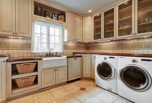 Country Laundry Room with Crown molding, limestone tile floors, Built-in bookshelf, Casement, can lights, Standard height
