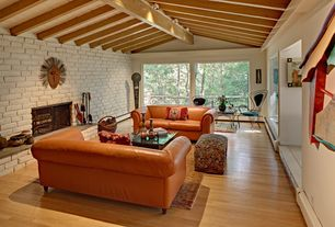Eclectic Living Room with stone fireplace, Africanart.com african chokwe mask, Laminate floors, Exposed beam, Exotic mask
