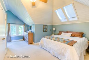 Cottage Master Bedroom with Ceiling fan, Crown molding, Carpet, Standard height, Casement, Skylight, Built-in bookshelf