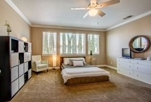 Contemporary Guest Bedroom with Ceiling fan, Carpet, Crown molding