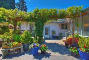 Cottage Landscape/Yard with Trellis, Raised beds, French doors, Casement, Pathway, exterior stone floors