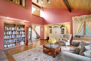 Traditional Living Room with Built-in bookshelf, Ceiling fan, Exposed beam, picture window, can lights, flush light