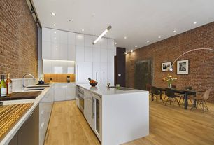 Modern Kitchen with Flush, Kitchen island, flush light, Pendant light, Corian Solid Surface Counters in Designer White