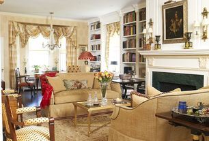 Traditional Living Room with interior wallpaper, stone fireplace, Laminate floors, Wall sconce, Crown molding, Fireplace