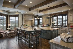 Country Kitchen with Pendant light, Exposed beam, Paint, Flat panel cabinets, can lights, counter height dining table