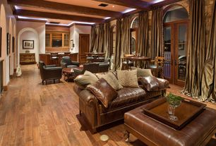 Mediterranean Living Room with Ralph lauren home - aran isles leather sofa, Crown molding, French doors, Transom window
