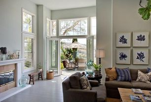 Living Room with picture window, Hardwood floors, Paint, Transom window, double-hung window, High ceiling, French doors