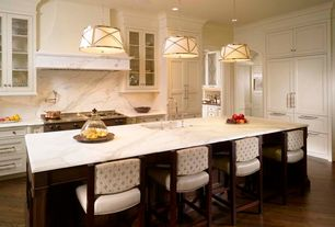 Traditional Kitchen with Pendant light, full backsplash, Complex marble counters, Inset cabinets, Standard height, can lights