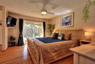 Modern Guest Bedroom with Ceiling fan, flush light, Laminate floors